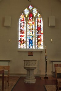 The magnificent stained-glass window and Font