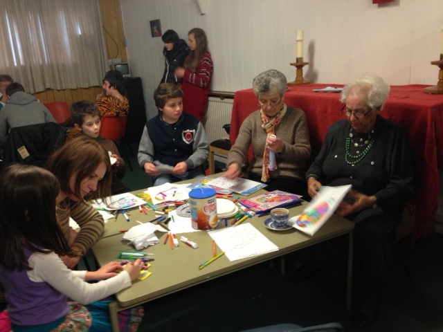 Adults on the children's paint table